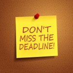 do not miss the deadline words on post-it over brown background