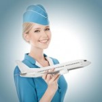 Charming Stewardess Holding Airplane In Hand.