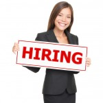 Job woman showing hiring sign. Young smiling Caucasian / Asian businesswoman isolated on white background.