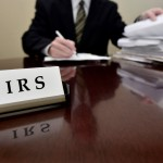 TaxConnections Picture - IRS Man At Desk 5 - square