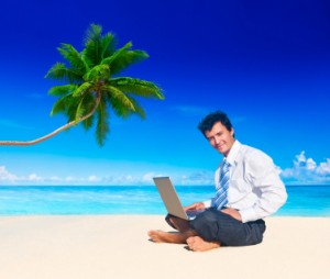 TaxConnections Picture - Man with Laptop at Beach