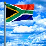 South Africa waving flag against blue sky