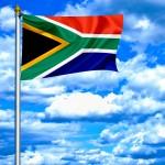 South Africa waving flag against blue sky