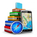 Creative business travel, tourism and GPS navigation concept: stack of color traveling cases or bags, modern black glossy touchscreen smartphone with GPS navigation  map application and blue metal magnetic compass isolated on white background