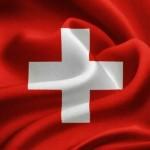 flag of Switzerland waving in the wind. Silk texture pattern