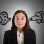 Businesswoman stressed with the brain in smoke