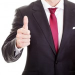 Satisfied businessman showing thumb up, isolated on white