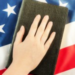 iStock_Hand On BibleXSmall